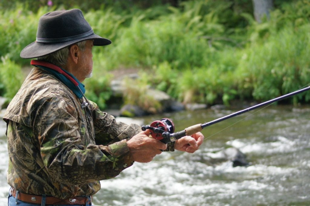 Fisherman Using a Casting Rod on a River