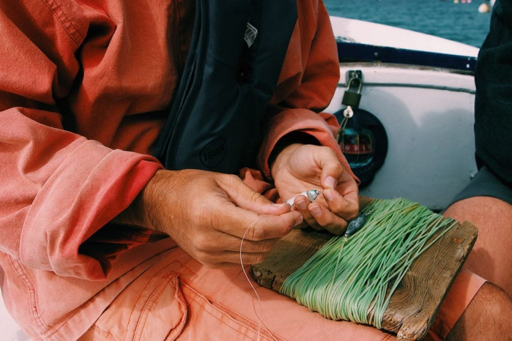Man Preparing a Fishing Line